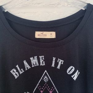 Hollister Tops - Blame It On My Wild Soul Graphic Tee